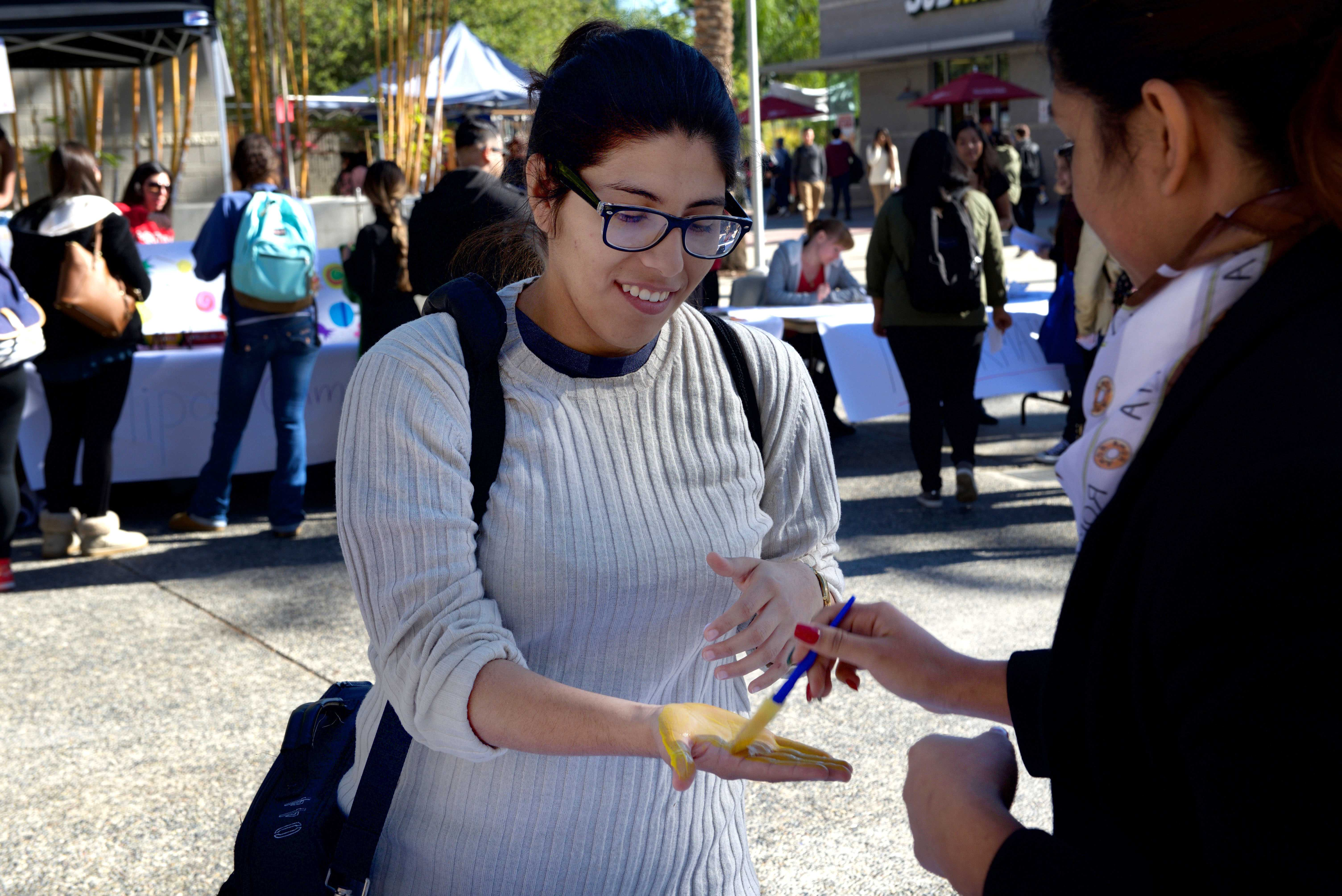 Color printing csun - Psychology Major Nereida Contreras Gets Her Hand Painted To Leave A Hand Print On One Of The Banners On The Tables Photo Credit Alejandro Aranda