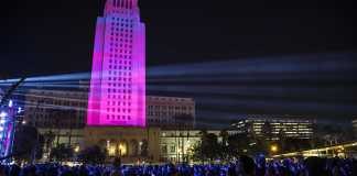 Crowds look up at Los Angeles city hall which displays the countdown to 2017