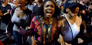 """Protesters chant, """"Black lives matter"""""""