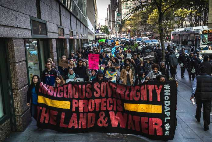 People in New York protest the North Dakota access pipeline