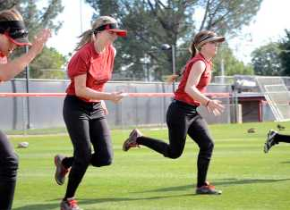 CSUN softball team participates in warm-up exercises