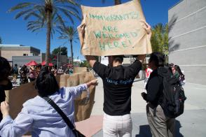 "Students holding signs and chanting ""education not deportation"" at the protest against Customs and Border Protection recruitment. (Photo credit: Alejandro Aranda)"
