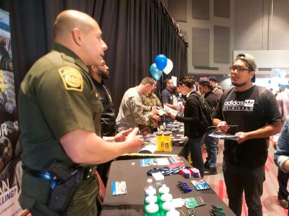 Student speaks with Customs and Border patrol officers about careers
