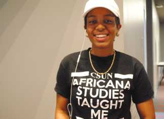 """woman wears a t-shirt which reads, """"csun africana studies taught me"""""""