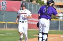csun player pictured after completing home run