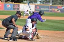 holy cross player hits the ball