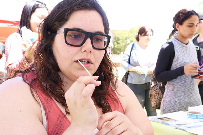 O'connor pictured with a small tube in her mouth getting a sample of her saliva