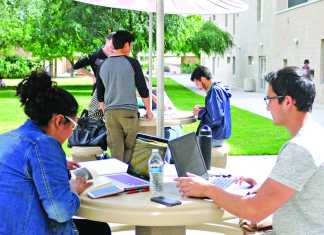 students work on their laptops outside of manzanita hall