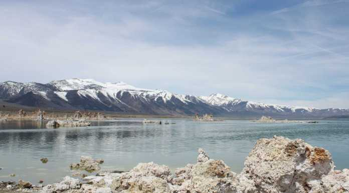 the sierra's are pictured next to a large body of water