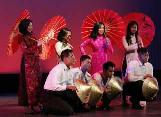8 students perform a dance together
