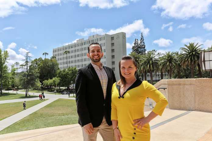 students pose for a photo in front of the oviatt library