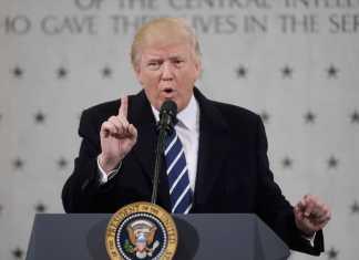 Trump speaks at podium