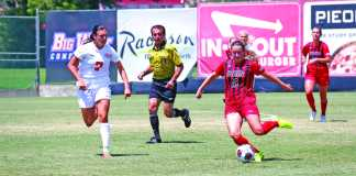 CSUN soccer player prepares to kick the ball