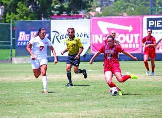 CSUN soccer player prepares to kick the ball