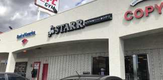 pictured store front of Starr beauty store in black and white lettering
