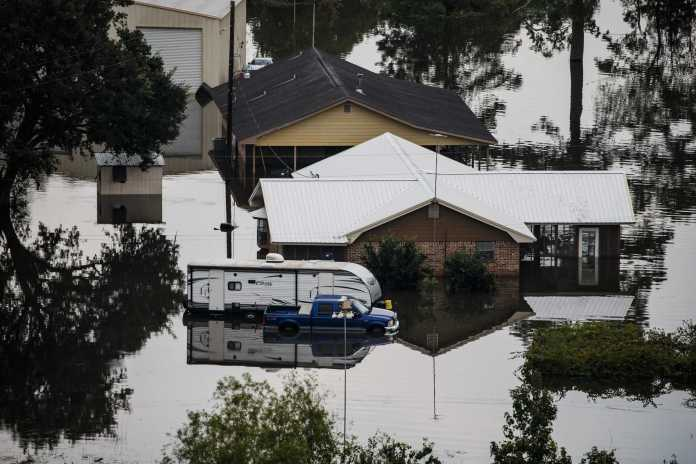houses and cars submerged in water
