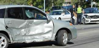 grey car thats been in an accident