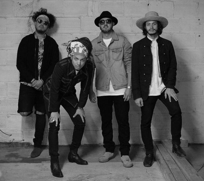 4 men posing black and white photo