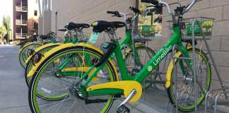 green and yellow Lime Bike in bike rack