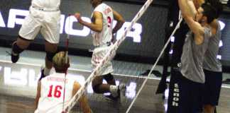 CSUN volleyball team player goes to spike the ball on opposing teams side