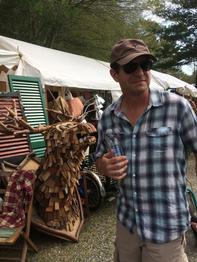Jim with a giant a giant, wood-scrap moose head at Brimfield