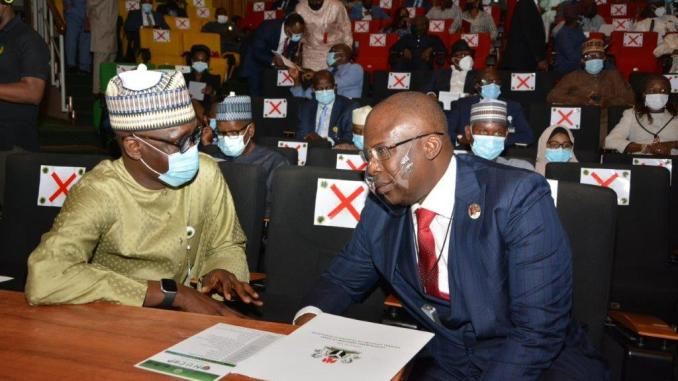 Minister of State for Petroleum Resources, Chief Timipre Sylva, and NNPC GMD, Mallam Mele Kyari, conferring during the launch of the Nigerian Upstream Cost Optimisation Programme (NUCOP) held to rally oil and gas industry stakeholders to achieve the $10 per barrel production cost target by adopting cost reduction measures... Tuesday.