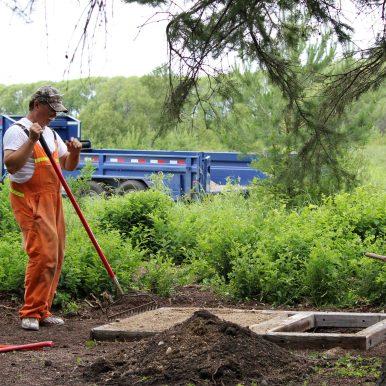 Wesley Gushuliak preparing base for new churchyard toilet (06-Jul-2013)