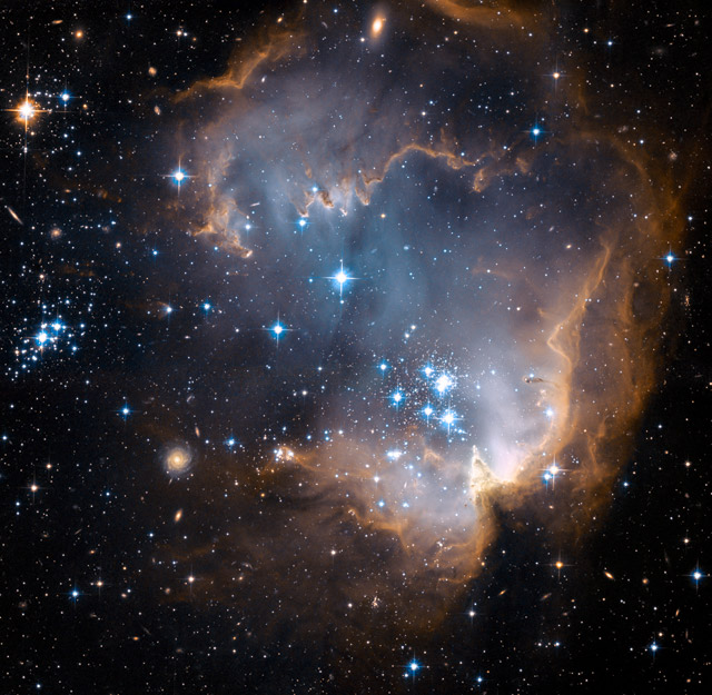 This new image taken with NASA's Hubble Space Telescope depicts bright, blue, newly formed stars that are blowing a cavity in the center of a star-forming region in the Small Magellanic Cloud.