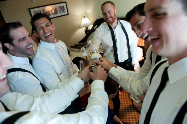 Groomsmen cheersing on wedding