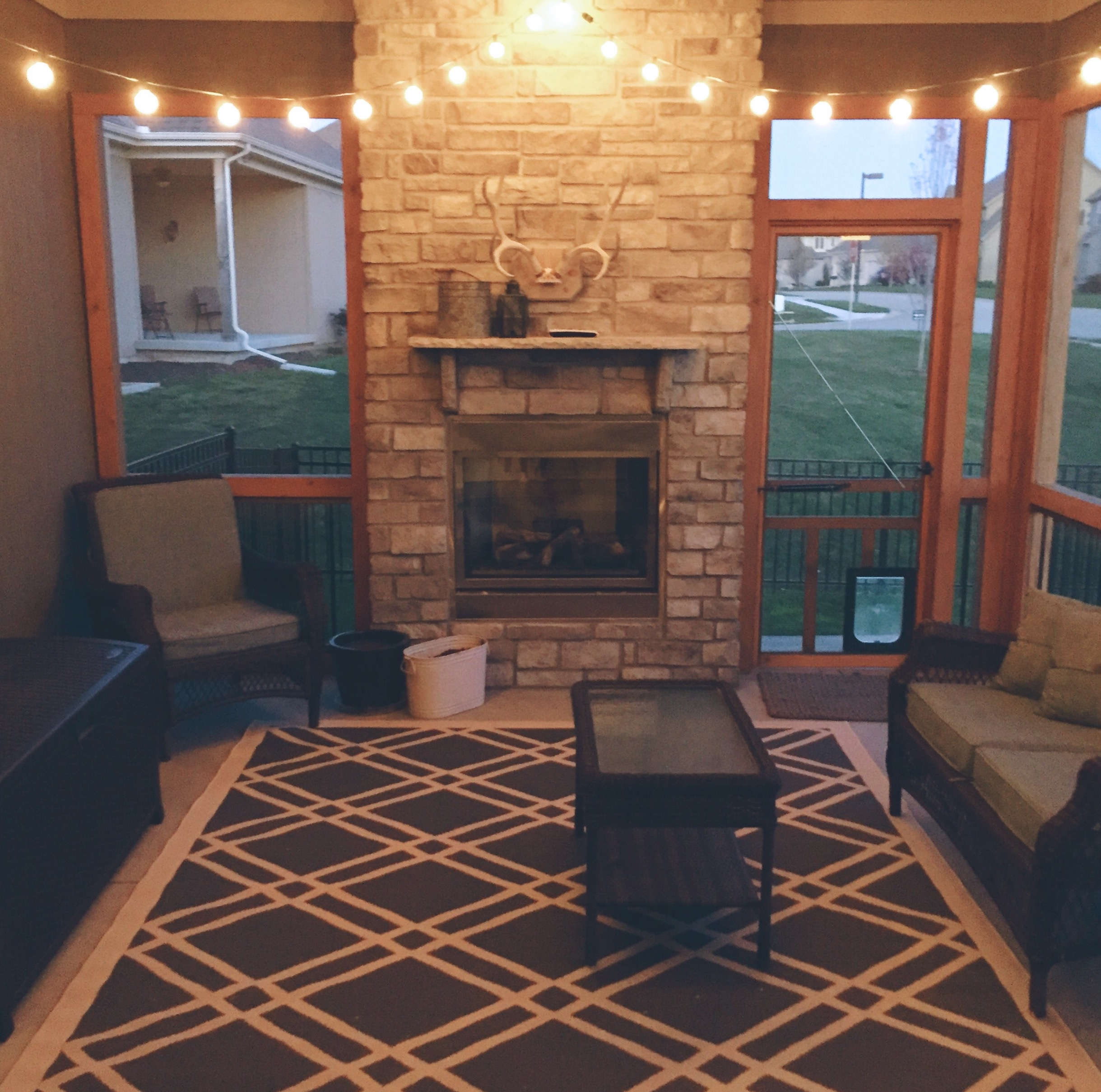sunflower state of mind: screened porch with lights and fireplace