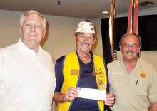 Lions Club members Gander and Sully with Commander Peer
