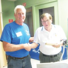 Tom Waldron described his experiences as a rescue helicopter pilot during the Vietnam Conflict during a presentation to the Sun Lakes Aero Club April 18. Here he is shown with Cannon Hill, SLAC President (left); photo by Gary Vacin.