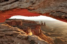 Photographers capturing Mesa Arch and Canyonlands N.P. by Burt Williams