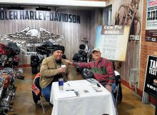 San Tan Crown Rotarians Terry Lubsen and James Kame hard at work selling Cow Pie Bingo tickets at Chandler Harley-Davidson January 7, 2017.