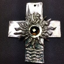 The first attempt at making jewelry using precious metal clay; created by Edie Leo