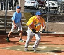 Recent action at the Field of Dreams: Batter Brian Jette and Umpire Dave Platt (Photo by Core Photography, LLC)