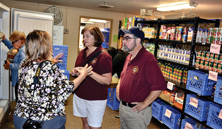 SLBLC Third Vice President Debra Curry and First Vice President Rich Iovino tour the food bank operations with Dara Gibson, AZCENDS Development Director (photo by Brian Curry)