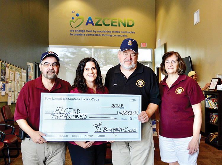 "SLBLC officers presenting a ""check"" to AZCEND Chief Executive Officer Trinity Donovan. Left to right: First Vice President Rich Iovino, Donovan, President Brian Curry, and Third Vice President Debra Curry (photo by Dara Gibson)"