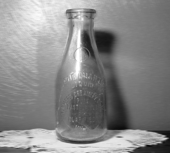 Milk bottle were very sturdy reusable items in 1897. From Etsy.com.