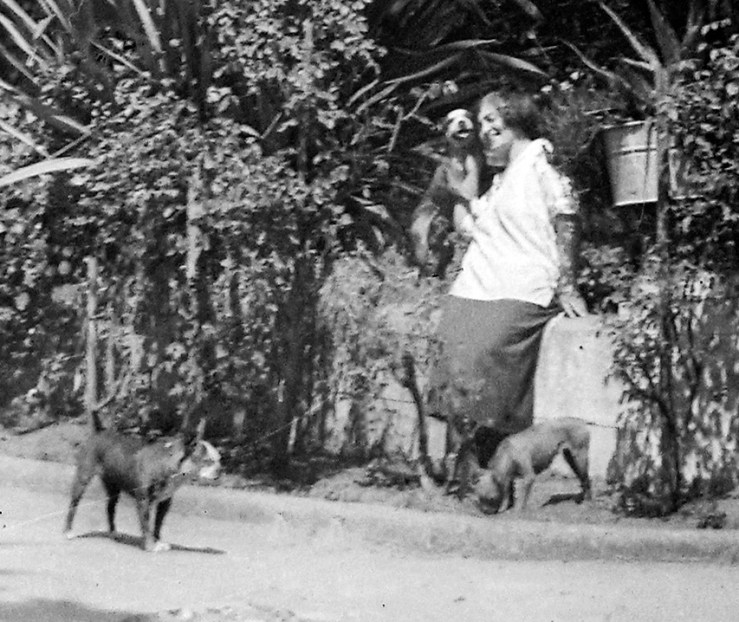 Detail of a photo taken in front of the Conservatory about 1913-1916. Temperance Merralls, accompanied by her dogs -- note two pit-bull terrier pups at her feet, one by her head. Courtesy the Hartsough Family.