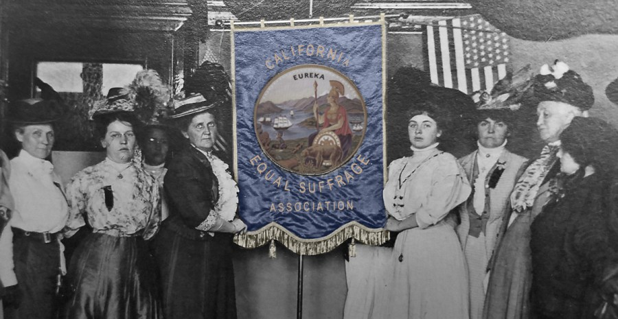 1908. Johanna Pinther (left of banner) and Jeanette Pinther (right of banner). Photo: California Historical Society.
