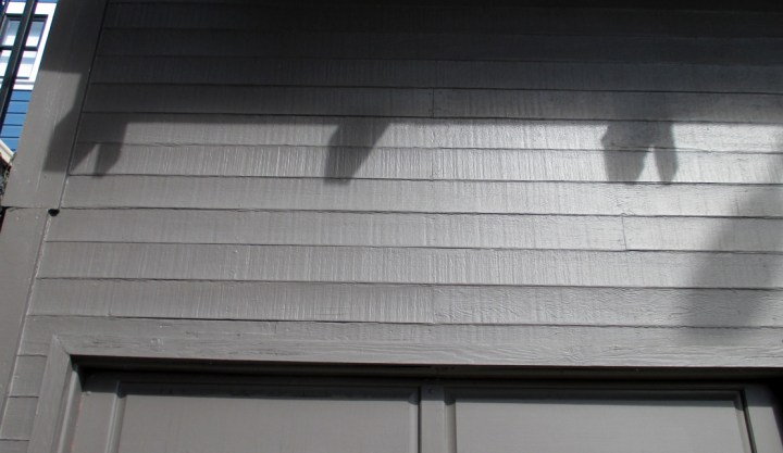 2019. The re-sawn redwood siding, originally exposed, can still be seen through the paint. Photo: Amy O'Hair