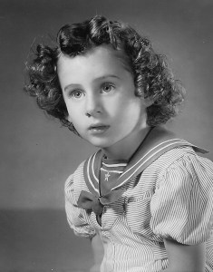 About 1941. Ann Marie Garvin. Reminiscent of Shirley Temple in her sailor dress. Photo courtesy Jacqueline Durgin-Beck.
