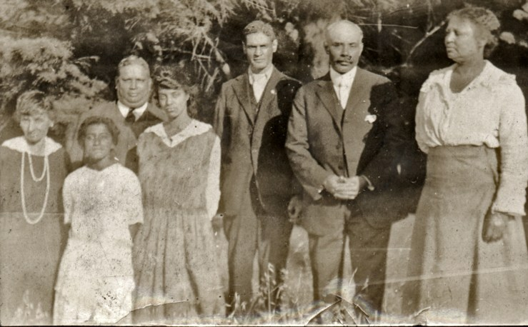 1919. Group photo taken in front of the Laidley Street house. (L to R) Harriet Cady Lake, Marjorie Lake, Malvern Lake, Irma Tyrrel, Horatio Cady (?), Bertram Tyrrel, and Frances Tyrrel. Courtesy Charles Reid/Ivy Reid Collection.