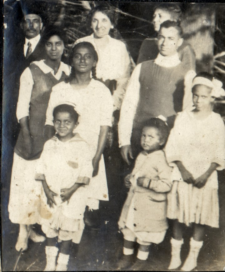 1920c. Group photo in front of the Laidley Street house. From left: Bertram Tyrrel, Irma Tyrrel, Marjorie Lake with Eleanor Hinds, Harriet Cady Lake in back, and next to her Frances Tyrrel, and Wendell Tyrrel with Marian and Frances Hinds in front.