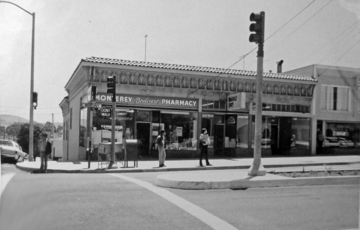 "1970c. 701-705 Monterey Blvd. Monterey Boulevard Pharmacy (on left) operated here 1920s-1970s, ""a real local resource"" recalled on old-timer. There was a small shopfront in the middle, once a barber, then a yarn shop. On the left there was Hofling's Grocery, 1920s-1960s, when it changed to a laundromat. Then the two were knocked together for a bigger laundromat. Finally, Railroad Café opened there in 2000. San Francisco Office of Assessor-Recorder Photographs Collection, San Francisco History Center, San Francisco Public Library sfpl.org/sfphotos/asr"