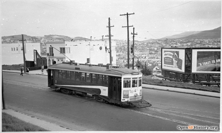 1942. Monterey Blvd at Detroit. Top of Lower Detroit Steps hidden behind streetcar. Three people have just alighted from car. OpenSFHistory.org