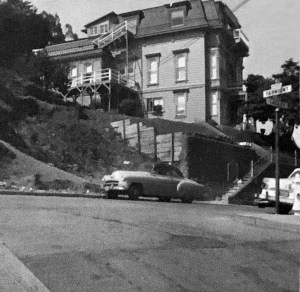 1957c. The Poole-Bell House taken by Joe LoPresti during the time he owned it, with one of his cars in front. Photo courtesy Diane LoPresti Christensen.