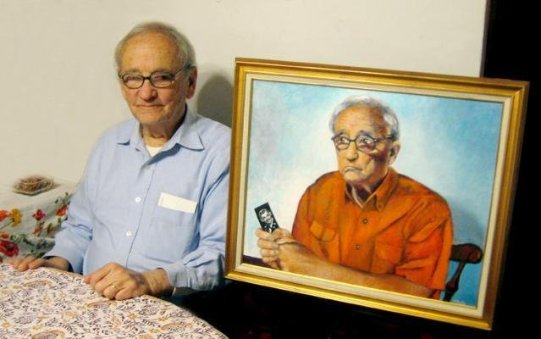 Christ Knauth poses with his new painted portrait by Deanna Yildiz.