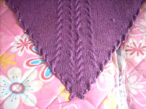 the tip of the shawl with cables inter-twined